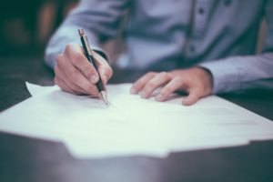 signing a merger or acquisition contract